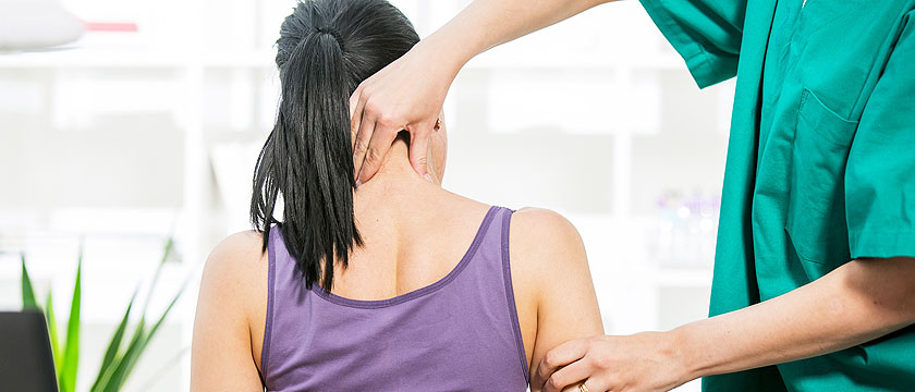 manual therapy for woman patient's neck pain