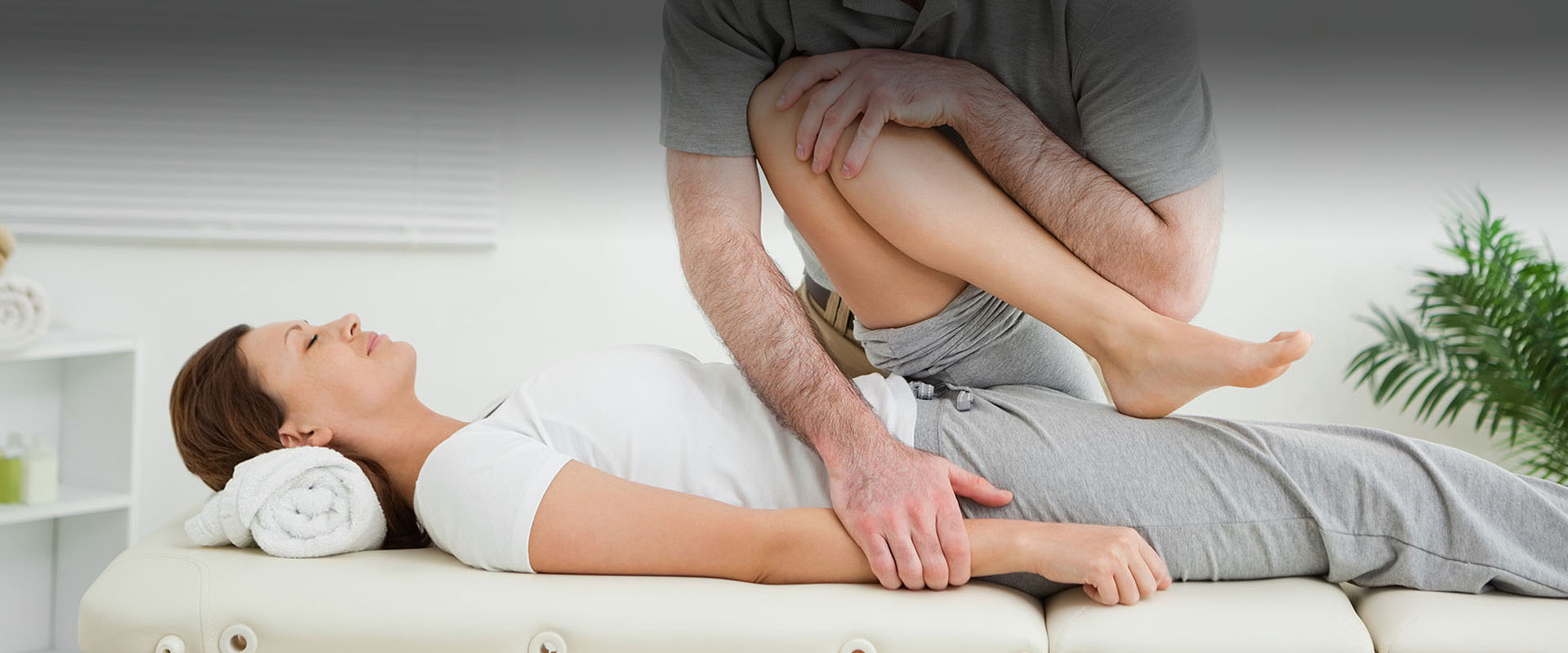 woman patient receiving manual physiotherapy to knee