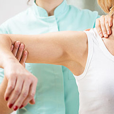 Woman patient having manual therapy to shoulder